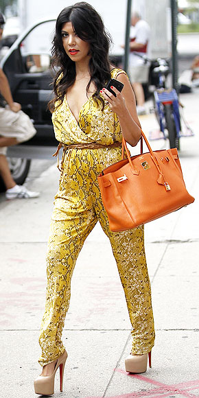 5fc2b329927b5d Kourtney looking very chic in a floral jumpsuit, nude Louboutins, and  carrying an Hermes Birkin bag